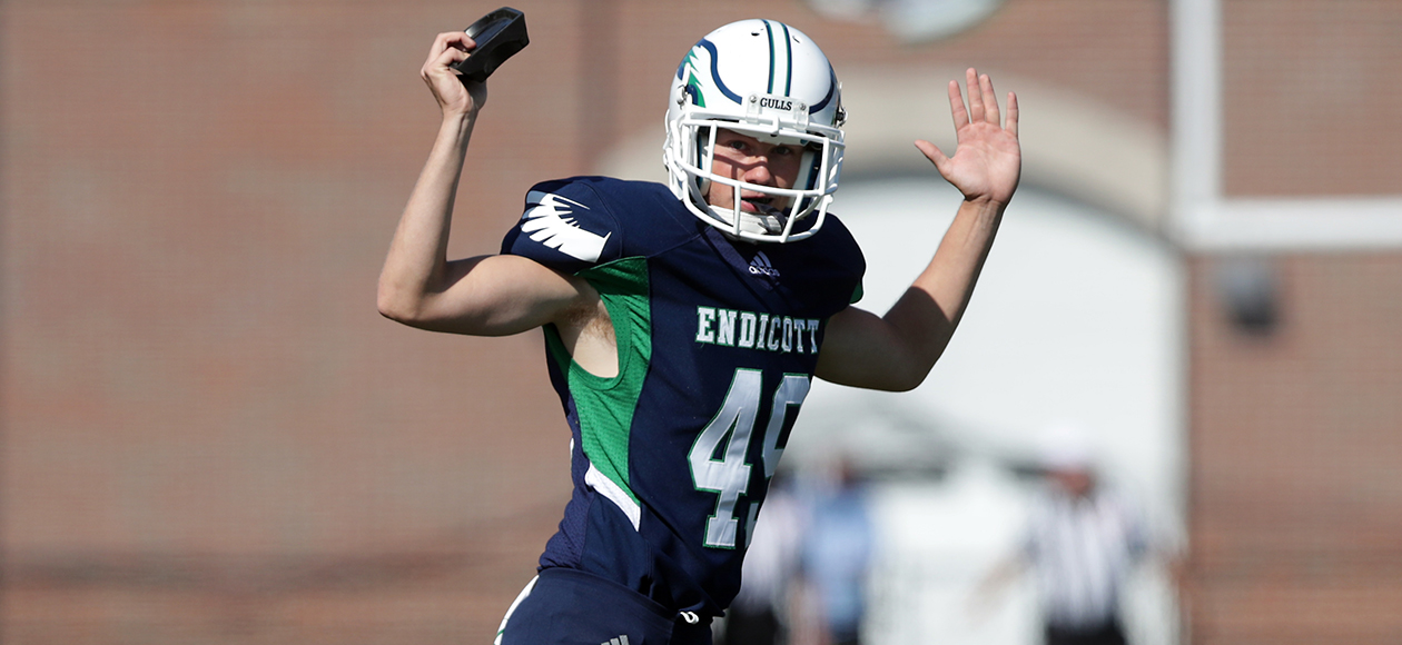 Nick DiCairano raises his hands after a made field goal.