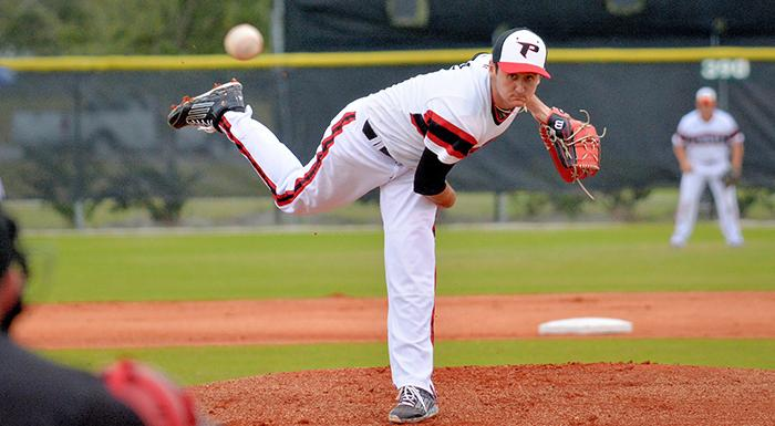 Jacob Kelley delivers a pitch to a Santa Fe hitter. (Photo by Tom Hagerty, Polk State.)