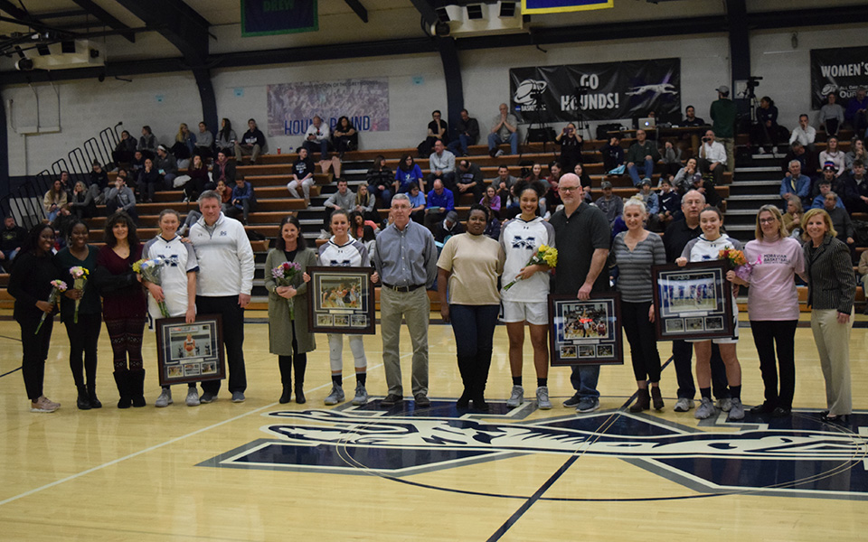 The women's basketball program's senior players and managers with their families before tip-off versus Elizabethtown College in Johnston Hall.