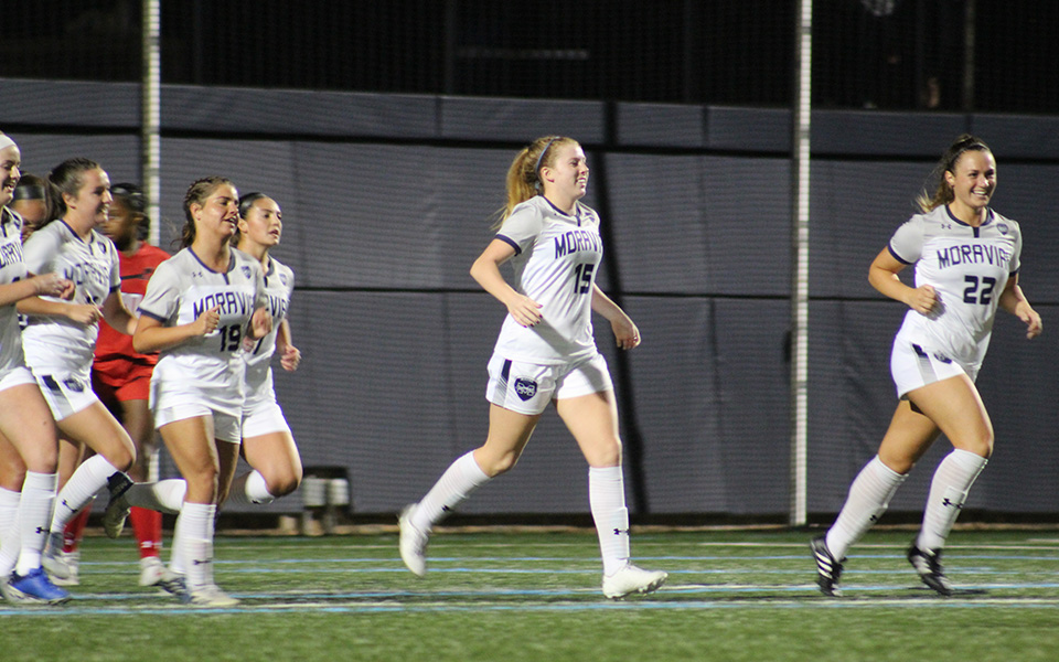 Senior Paige Weiss leads the Greyhounds back towards midfield after heading in the game-winning goal on a corner kick versus Albright College on John Makuvek Field.