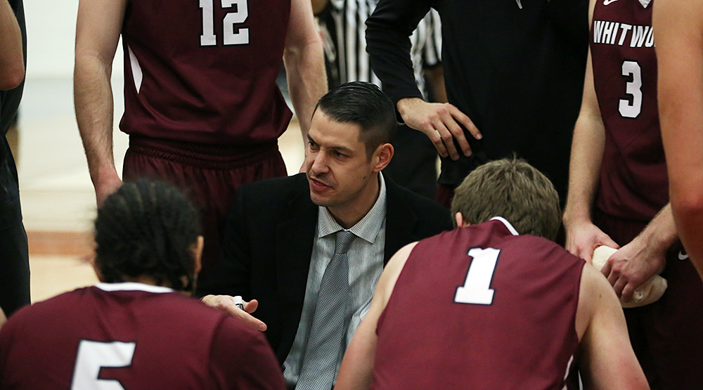 Matt Logie in the huddle with his team. (Photo by Larry Radloff, d3photography.com)