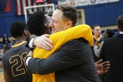 Willson (right) embraces Noah Walker after ODAC Title game.