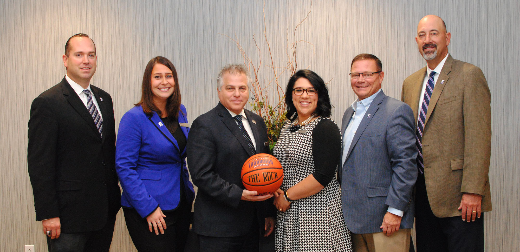 Representatives from University of Scranton Athletics met with representatives from the Hilton Scranton and Conference Center to discuss plans for a pair of upcoming basketball tournaments. From left, Trevor Woodruff, women's basketball head coach; Victoria Rogers, Hilton Scranton director of sales and marketing; Robert Trotta, Hilton Scranton general manager; Danielle Borkowski, Hilton Scranton sales manager; Dave Martin, director of athletics at The University of Scranton; and Carl Danzig, men's basketball head coach.