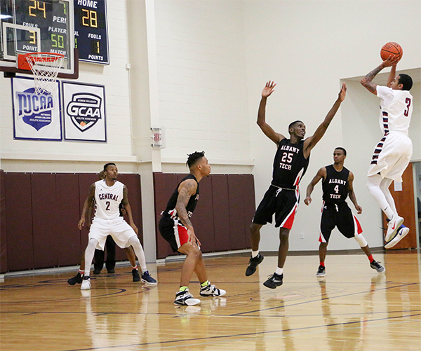 Freshman Mike Laster (3) shooting over Albany Tech defenders.