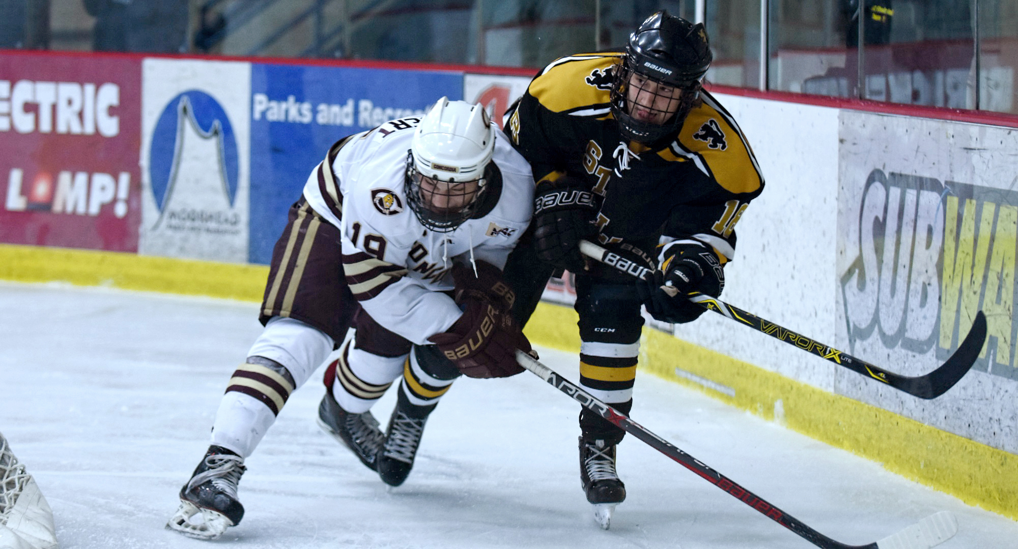 Sophomore Tyler Bossert tangles with one of the St. Olaf players during the Cobbers' 4-2 win. Bossert had a goal and two assists to help CC to the series sweep.