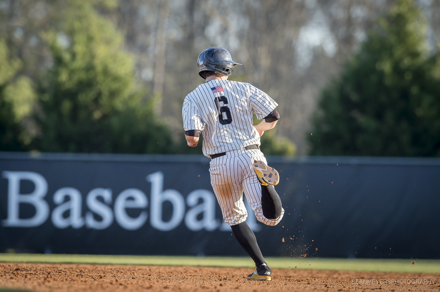 Cody McKenzie rounding second base. Photo courtesy of Sean Meyers