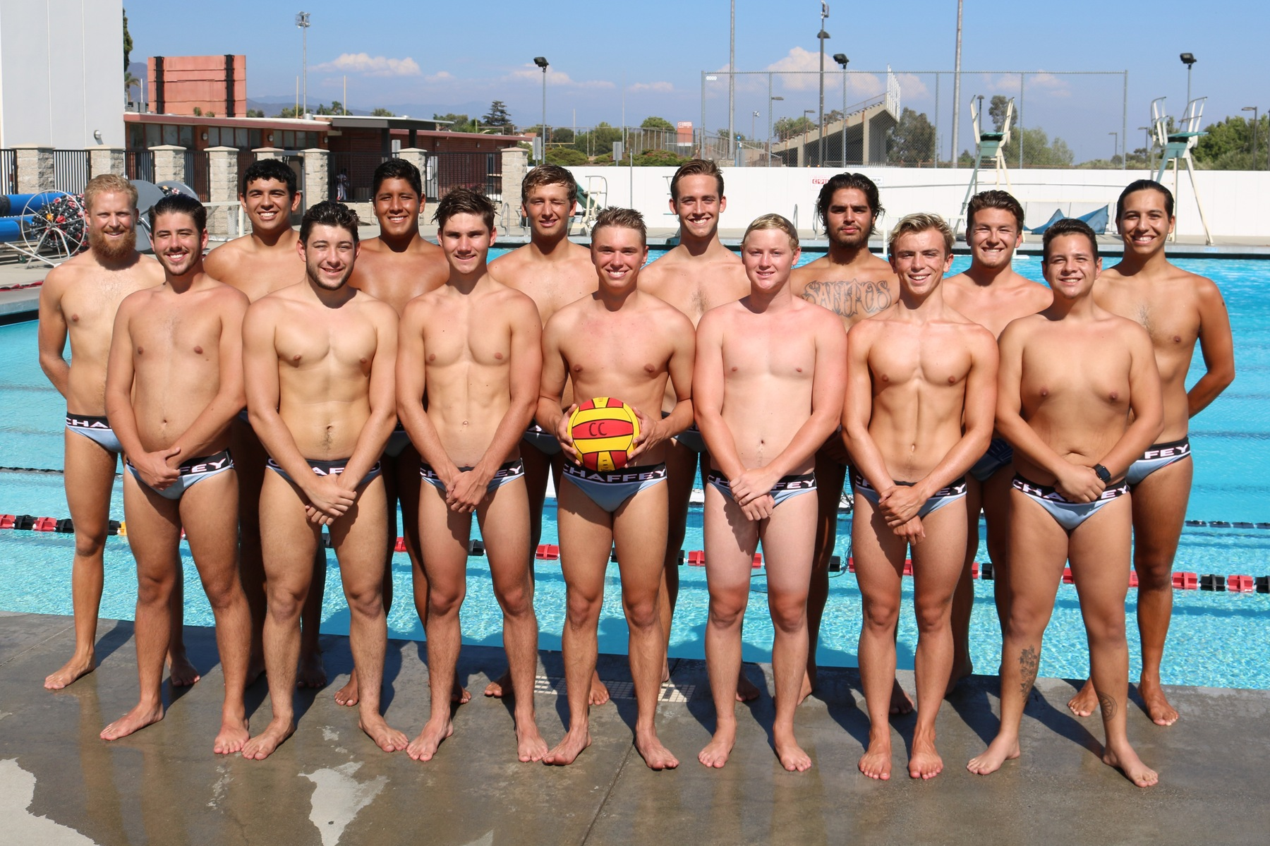 2018 Men's Water Polo team on the pool deck