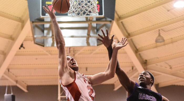 Stefan Nakic scores in Polk State's 80-75 win over Harcum College. (Photo by Tom Hagerty, Polk State.)