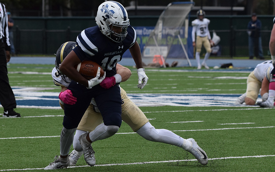Junior Alex Pierce looks to break a tackle after a reception versus Juniata College at Rocco Calvo Field.