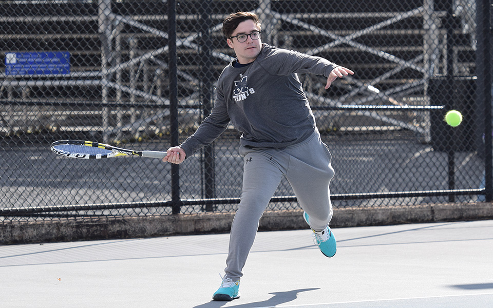 Senior Isaac Schefer returns a shot during doubles action versus Delaware Valley University at Hoffman Courts.