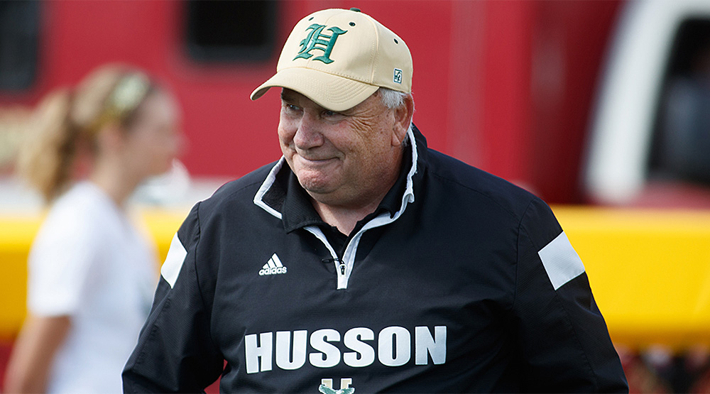 Gabby Price in a Husson cap and windbreaker. (Husson athletics photo)