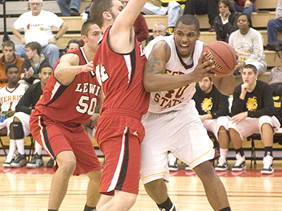 FSU's Justin Keenan drives to the basket versus Lewis (Photo by Ed Hyde, FSU Photo Services)
