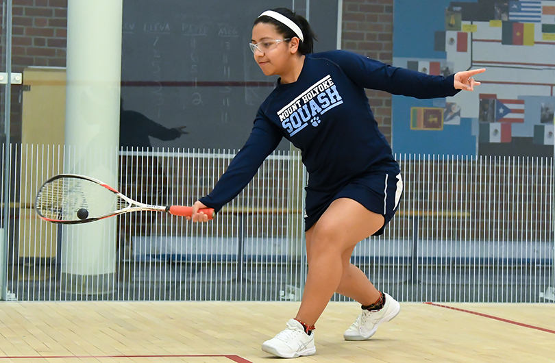 Action photo of Lyons squash player, Giselle Cabrera.