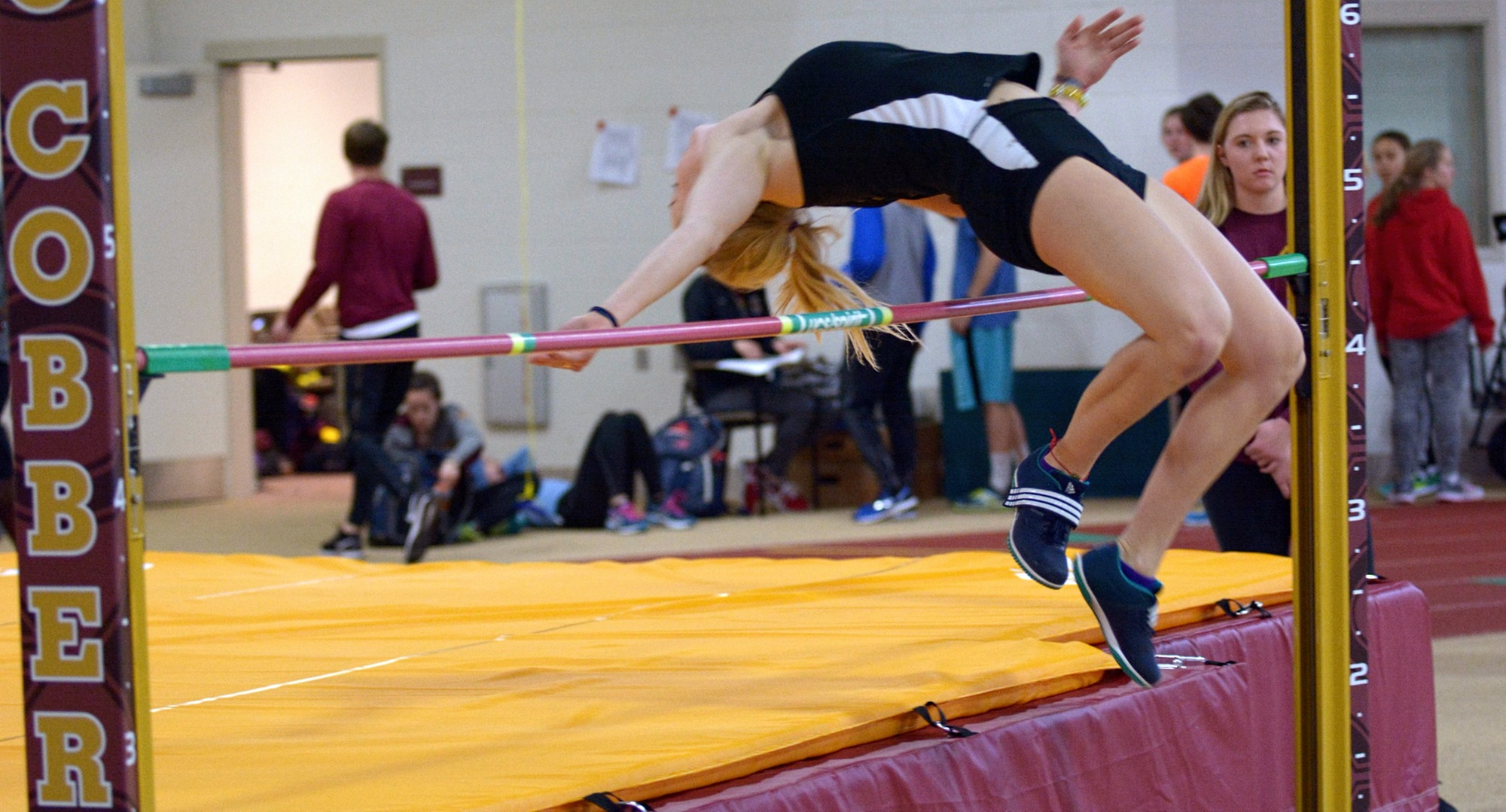Senior Mikayla Forness clears the bar in the high jump at the season-opening Cobber Duals Meet.