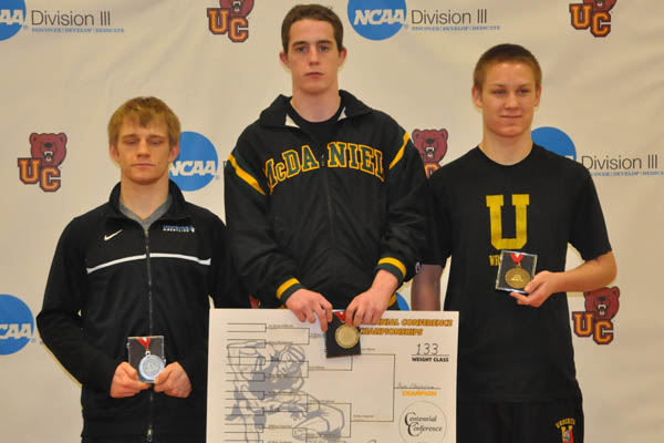 Ryan O'Boyle stands atop the podium after winning the 133-pound weight class.