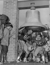 Members of the 1968 team ring the Victory Bell to celebrate a Bulldog win.