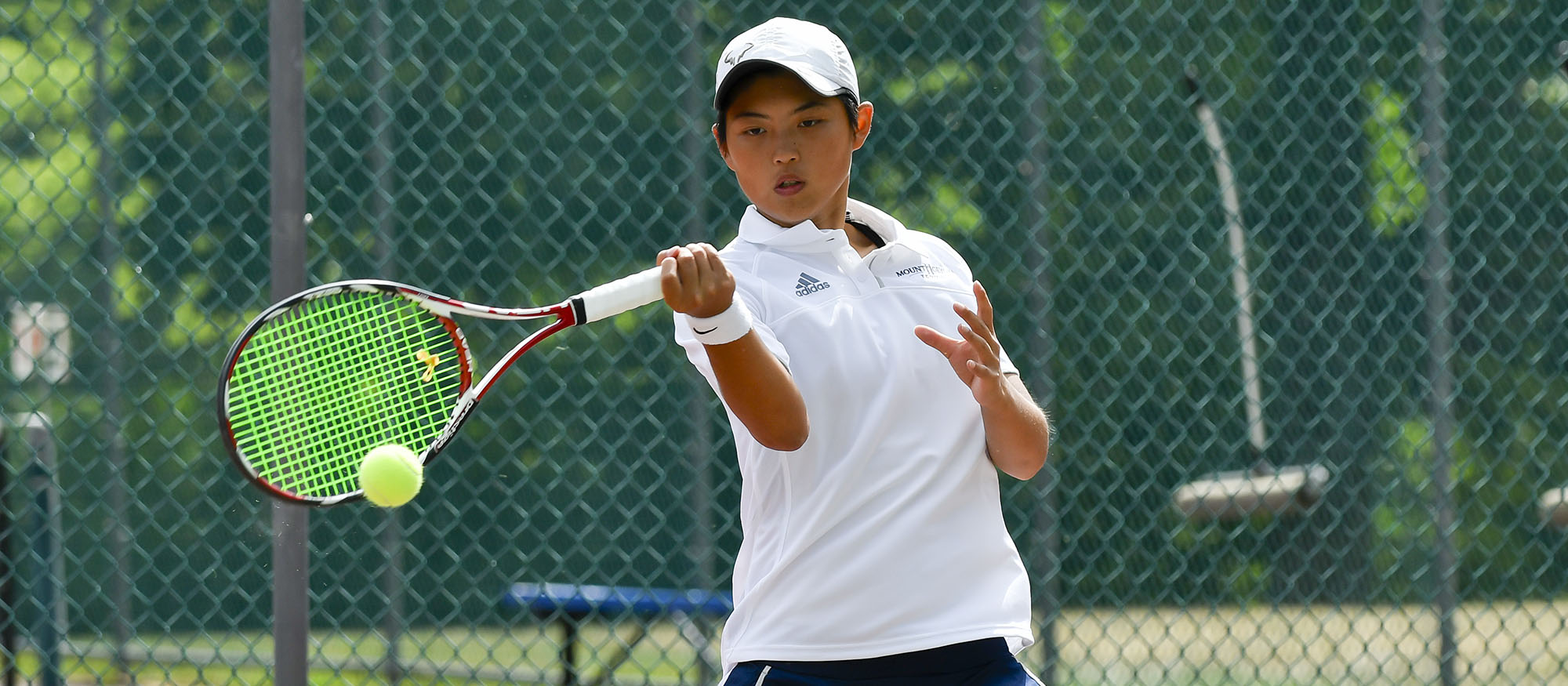 Action photo of Lyons tennis player Ching-Ching Huang