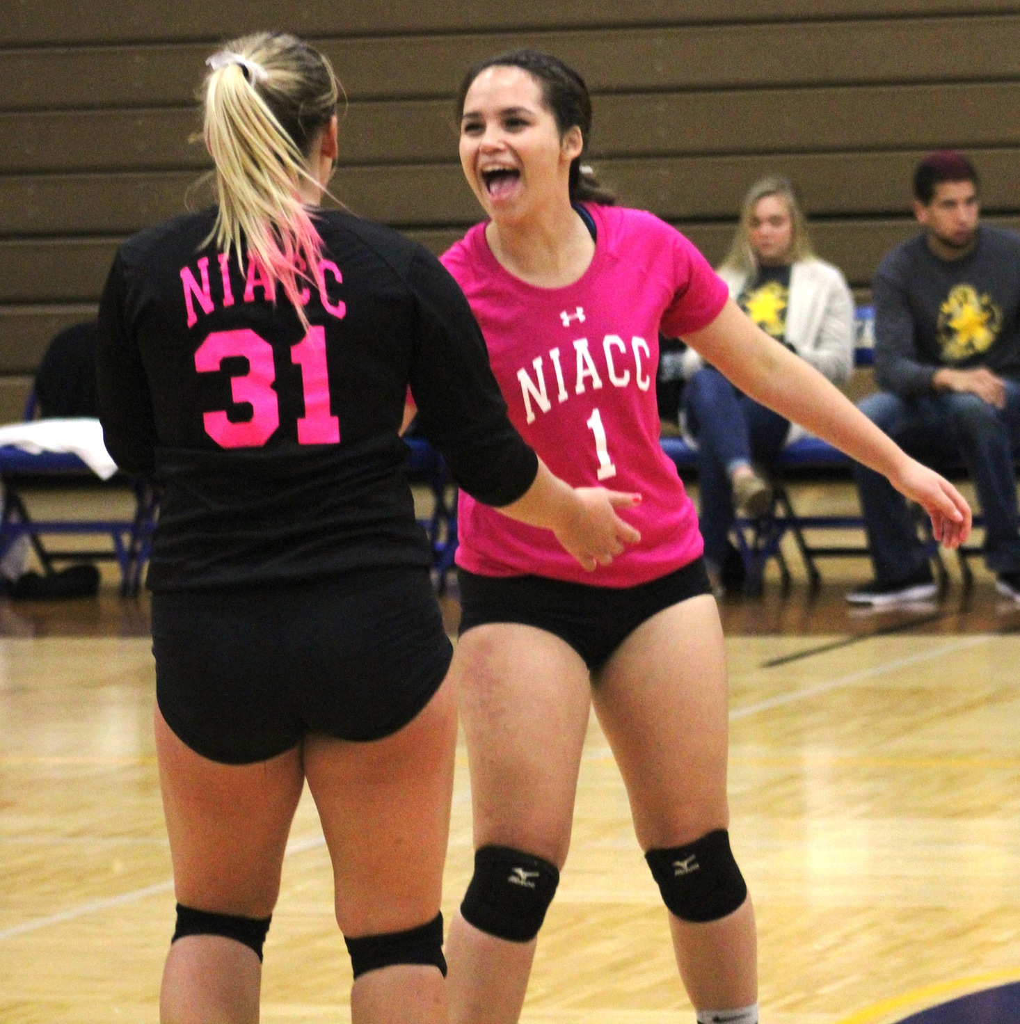 NIACC's Kyra Marquez (right) and Sammi Hyde celebrate a point in Wednesday's match.
