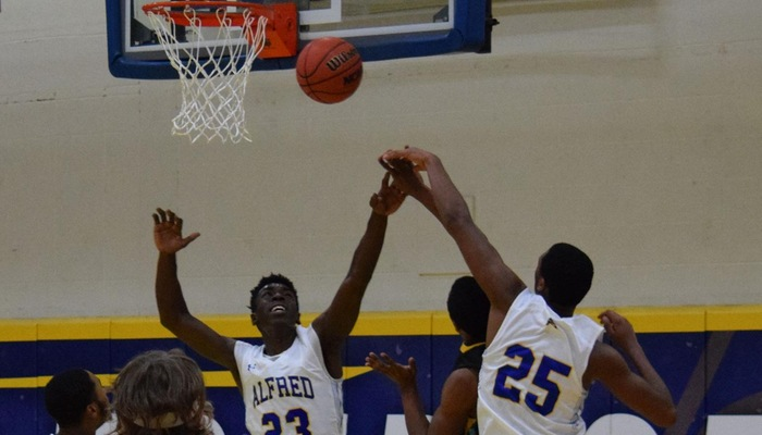 Marcus Rhett and Dante Jordan look for the block