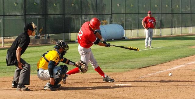 Nestor Linares drives the ball against Fullerton College. Linares hit a home run for the Dons in the fourth inning.