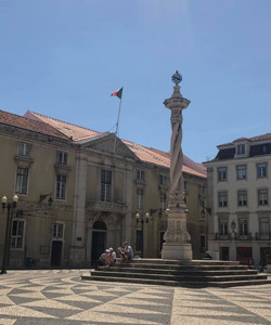 A square with a monument in Lisbon.