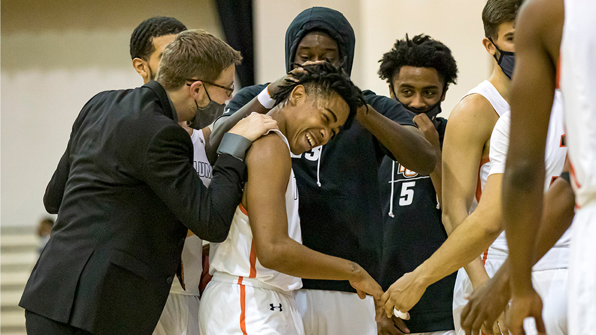 Freshman Kobe Funderburk is surrounded by his teammates as Tusculum defeated Wingate 87-75 (Photo by Chuck Williams)