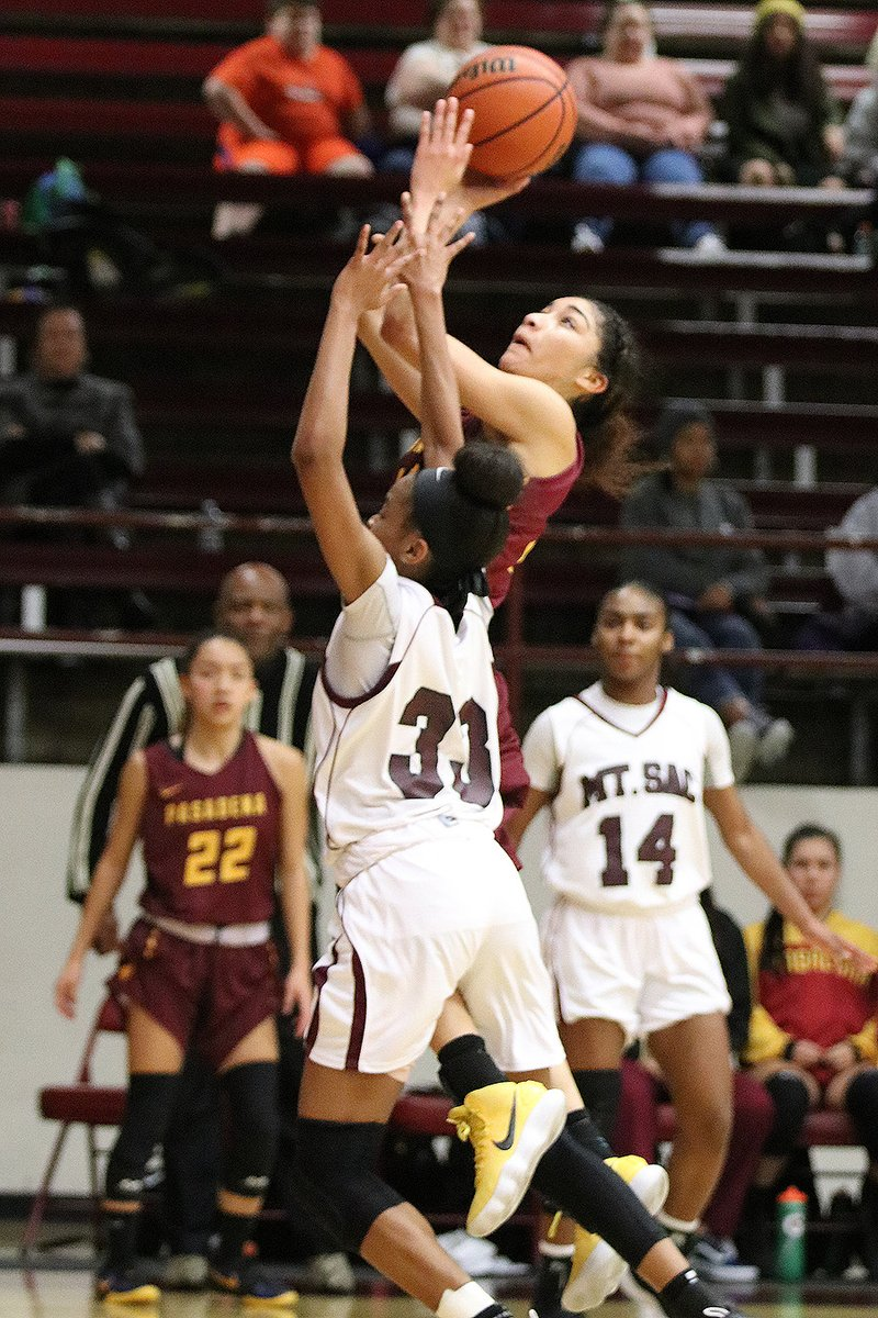 Daniela Mendez' late basket was PCC's final points in a 55-51 loss at Mt. San Antonio College Friday evening, photo by Richard Quinton.