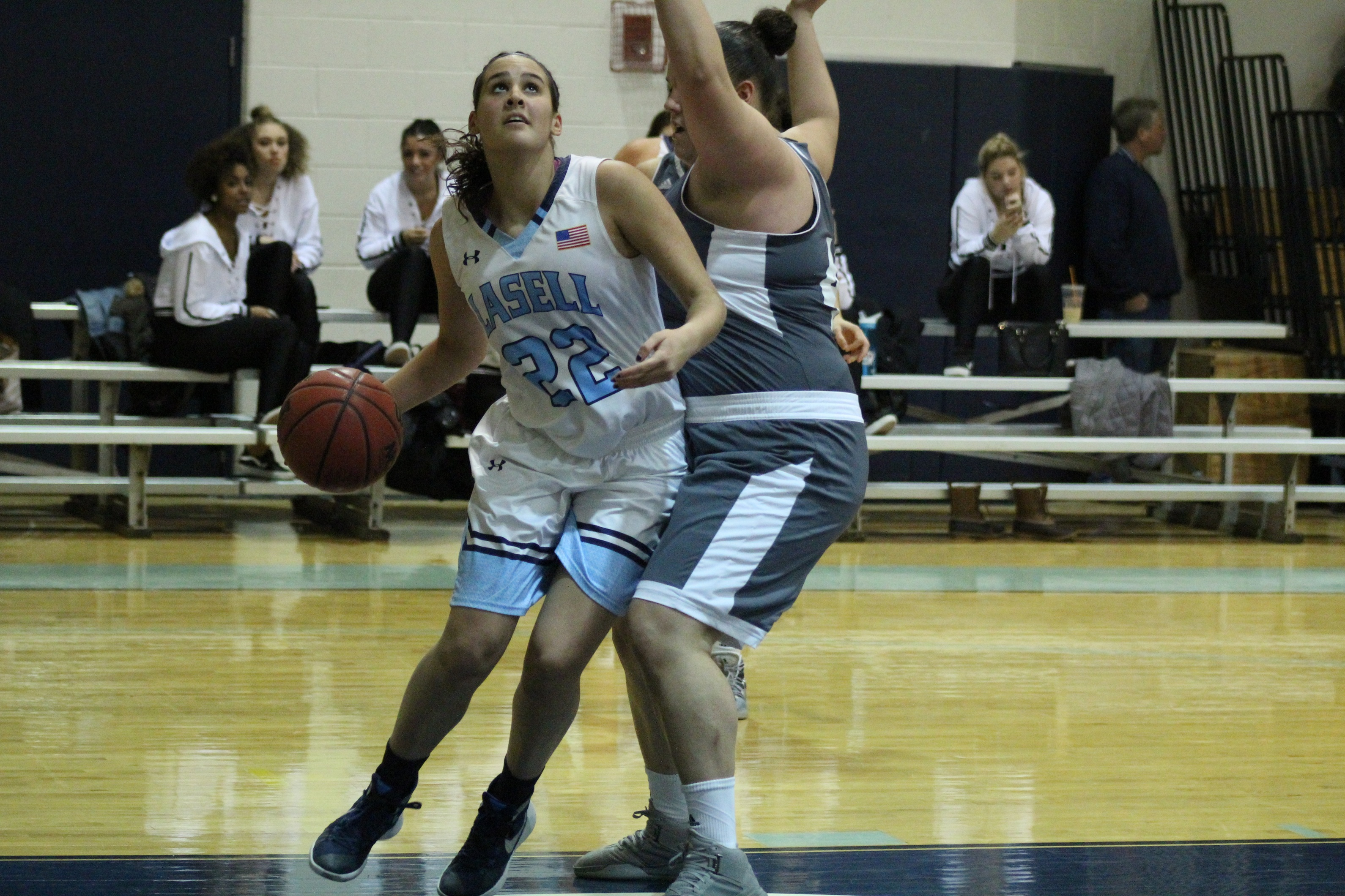 Lasers Fall to USJ 57-52 in GNAC Contest