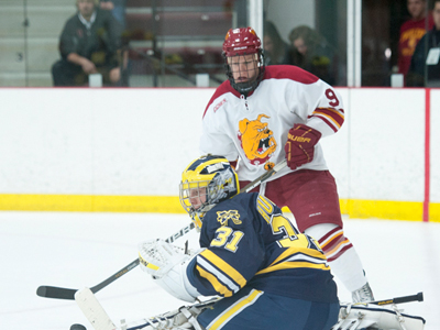 Ferris State's Travis Ouellette tries to put the puck past Michigan goaltender Shawn Hunwick during Saturday's home-and-home CCHA series finale.  (Photo by Ed Hyde, FSU Photographic Services)