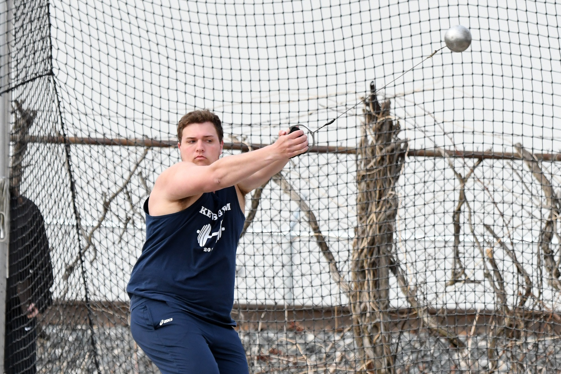 Chase Gaca releases the hammer throw