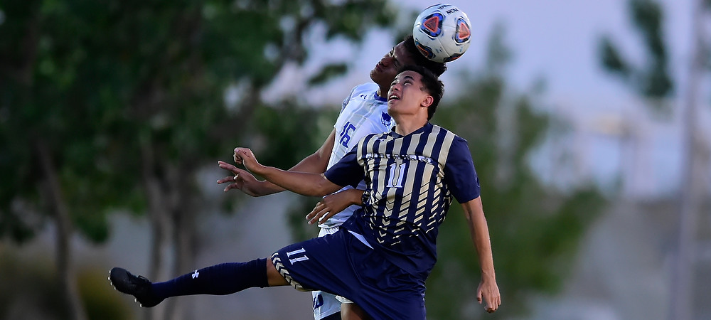 GU men's soccer player Brian Espanto goes up for a header against a defender