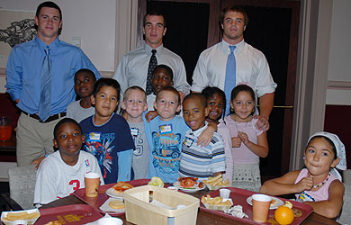 SU football players with local elementary children