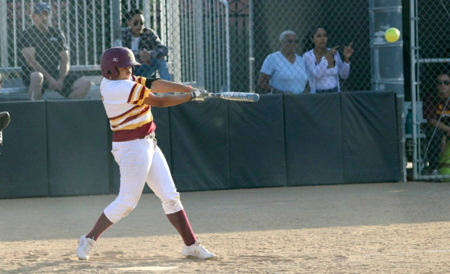Nat Velasquez rips her 2-RBI double during PCC's win Tuesday at Robinson Park, photo by Richard Quinton.
