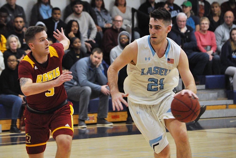 Lasell Men's Basketball nips Regis in home opener