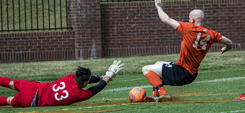 Luke Murphy is denied by Anderson keeper Gal Elyashiv in the 16th minute (photo by Chuck Williams)