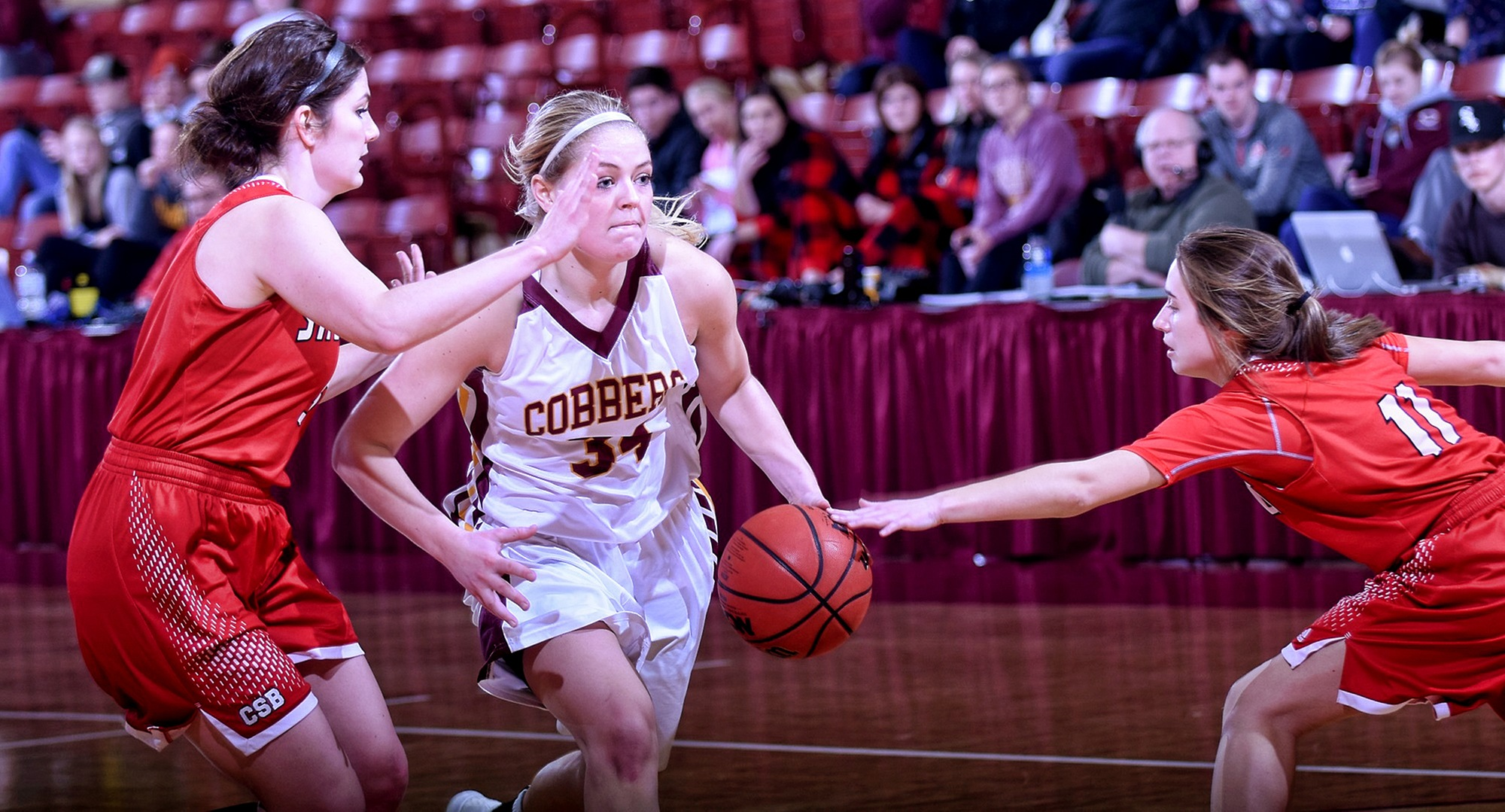 Senior Grace Wolhowe dribble through the defense in the second half of the Cobbers' game with St. Benedict. Wolhowe scored a career-high 27 points in the game.