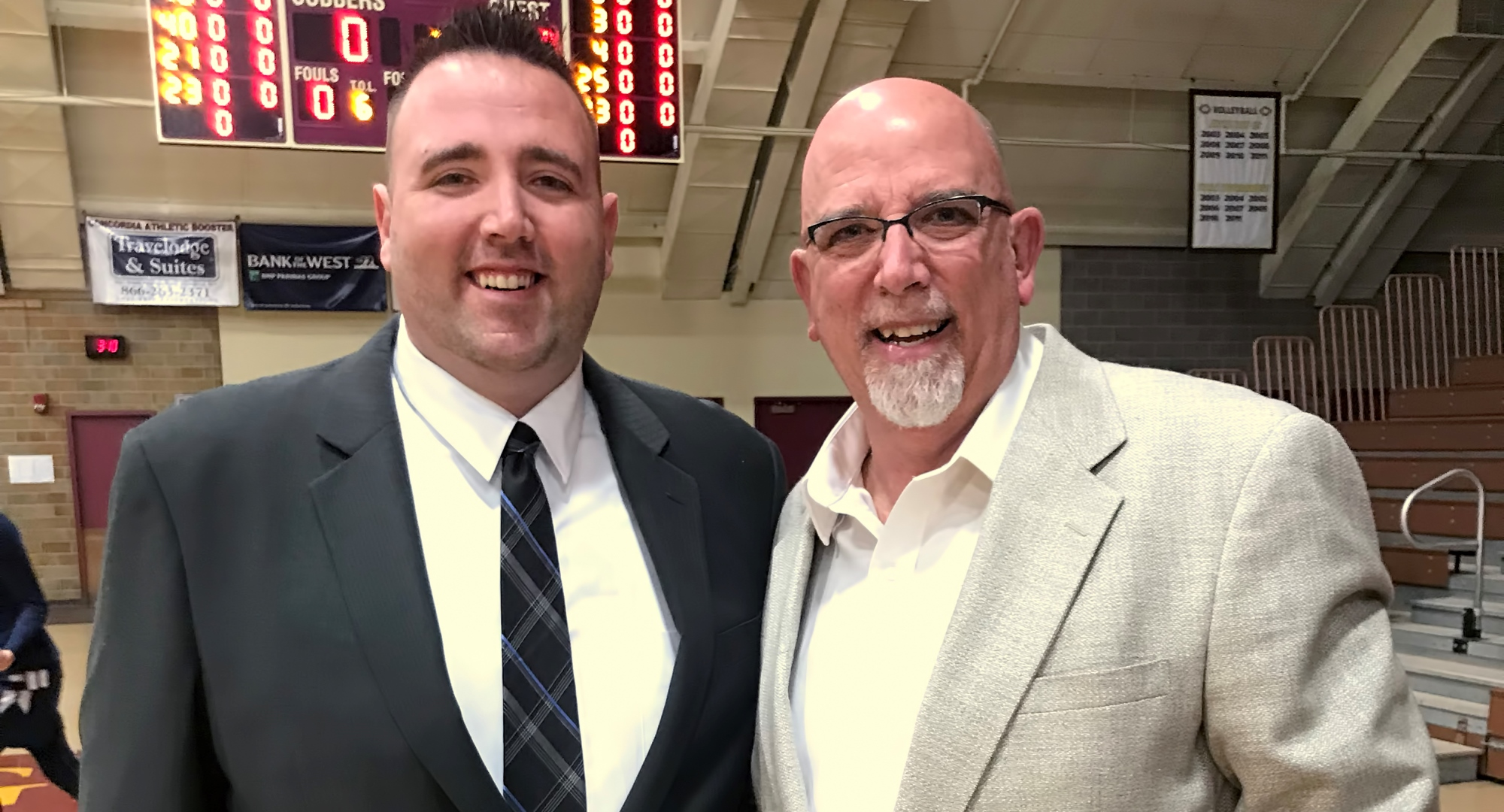 Cobber head coach Grant Hemmingsen (L) and his Dad George pose for a picture before Concordia's game with Bethel.