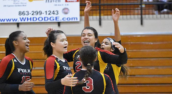 Dayanna Teixeira, Yue Wu, Alejandra Robles, Zoemy Barreto, and Suheily Colon celebrate after the Eagles beat Daytona State. (Photo by Tom Hagerty, Polk State.)