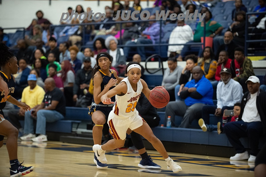 Breonca Ducksworth (23) drives vs. Mississippi Gulf Coast in last week's Region 23 Tournament championship game. Ducksworth was 8-of-8 from the free throw in the final 1:07 to secure a 68-57 win by Jones.  (photo:  JUCO Weekly)