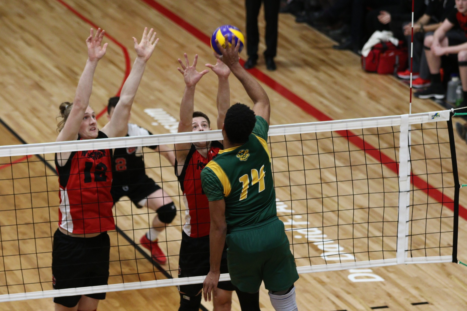 Garrett Jones (left) and Adrian Dyck team up to try and block Taryq Sani during the Wesmen four-set win on Friday night. (David Larkins/Wesmen Athletics)