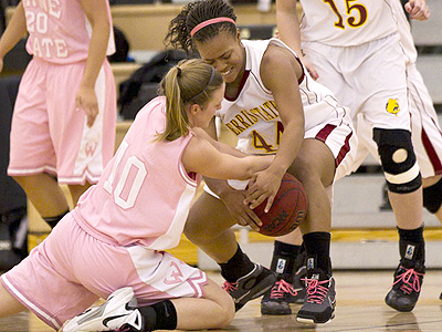 Ferris State senior Tiara Adams battles for the ball in the game versus Wayne State (Photo by Ben Amato)