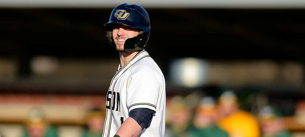Gallaudet's Matt Scuderi shows a smile before he gets ready to hit.