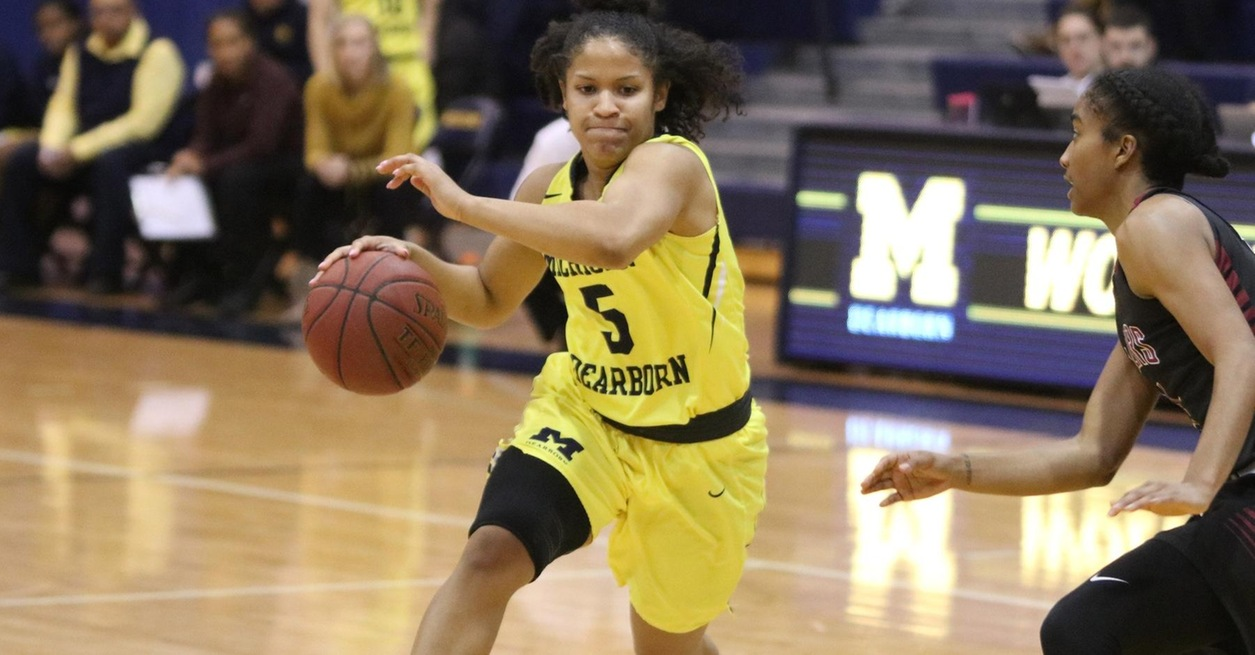 No. 22 Wolverines surge past Comets 85-53
