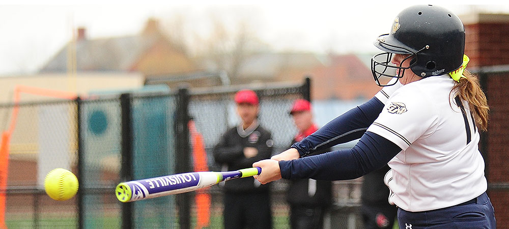 Gallaudet softball player Alyssa Barlow swings at a yellow softball from the lefthand side of the plate.