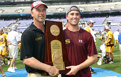 Coach Berkman and son Kylor hold the national championship trophy