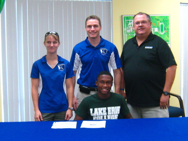 Riverview, Florida's Jarrod Evans (pictured with high school coaches) is one of six new members of the Storm men's track and field team.