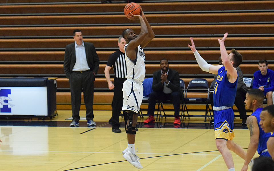 Senior John Hargraves takes a jumper during the first half versus Goucher College in Johnston Hall.
