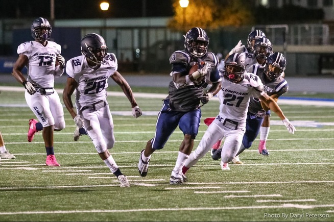 Rhamondre Stevenson breaks away for his 68-yard TD run against SD Mesa. He finished with 270 yards on the night.