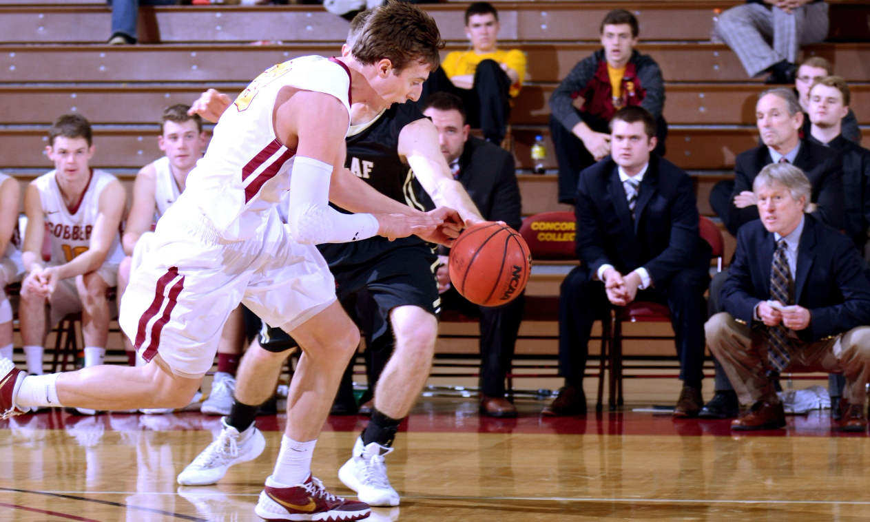 Jordan Bolger gets the steal and is fouled during the second half of the Cobbers' 62-61 win over St. Olaf. Bolger finished with a career-high 26 points.