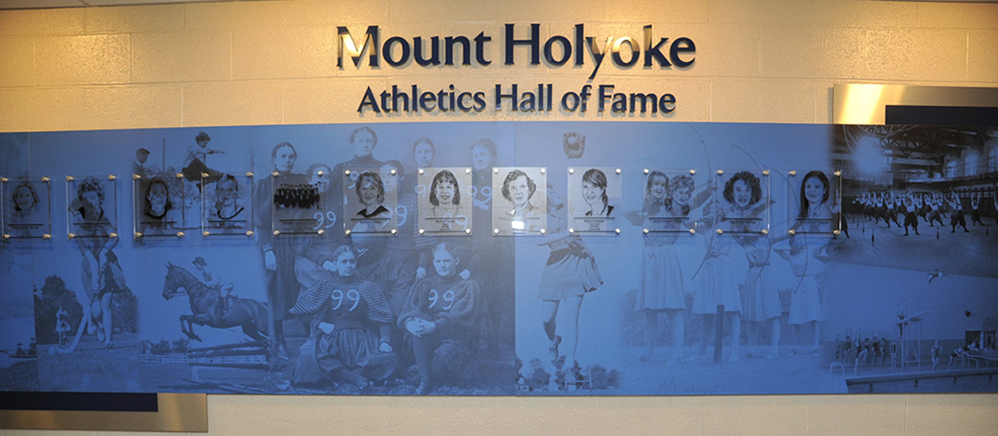Image of the Mount Holyoke Athletics Hall of Fame Wall within the Kendall Sports & Dance Complex.